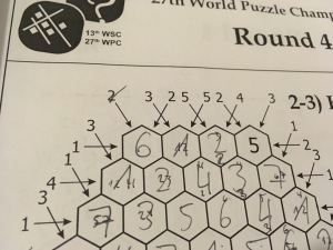 A hexagonal skyscrapers puzzle with a lot of clues.